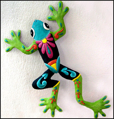 painted metal tree frog wall hanging